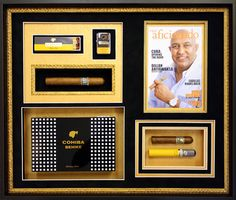 Custom framed cigar collage with fabric textured gold and black suede mat boards. A black shadowbox is complimented with a gold liner, which is also incorporated into the design. Save mementos for your own very unique collage! Get it designed and framed at Art & Frame Express in Edison, NJ.