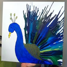 Jordan's peacock crayon art! I need to do this!!
