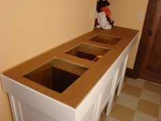 Laundry sorting table - traditional - basement - minneapolis - by Home Restoration Services, Inc.