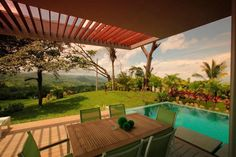 Architecture:Surface By Wooden Table On The Open Balcony With Extraordinary View To Natural Garden Or Backyard And Infinity Pool Area Breath...