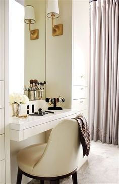 If your bathroom is small, carve out an area in the bedroom for makeup, jewellery and hair drying. (Here a dresser and mirror are positioned behind the bed, which also creates a dividing wall.) A small desk or dresser works wonders. Your partner will thank you!  Get this look: Cabinetry paint, in Ballet White, Benjamin Moore. Sconces, Studio B. Cabinetry design, Kimberley Seldon. Chair, Elte.