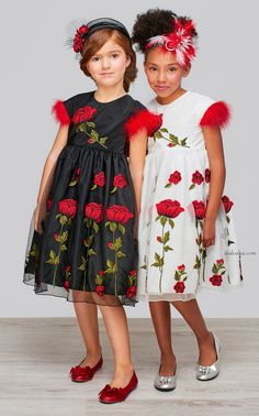 Gracing the pages of ALALOSHA, little Dolce& Gabbana's models keep sunny in luxe SS'15 look including the dot black dresses with carnation patterns