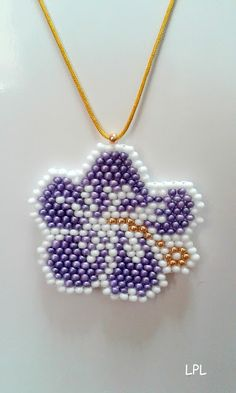BEADS and GEMS by LPL - Pendant purple Hibiscus flower   -  brick stitch - 9/o seed beads - in purple , white and gold colour.  Macrame cord 100mm in gold colour.   Design by  MigotoChou.