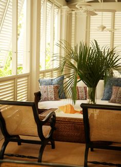 A very tropical look for a sun room  luv the chairs <3