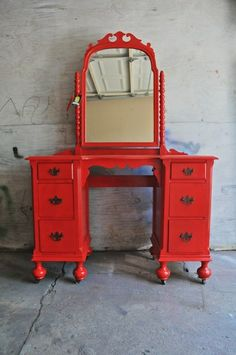 Red up-cycled vanity/dressing table on castors. Love it! Love furniture on castors.