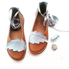 Handmade Fairytale inspired, quirky shoes, leathergoods & knitwear. Designed & handmade in England, sent Worldwide.