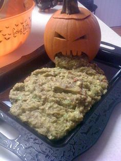 Jack o lantern and guacamole.  Oh, this is disgusting, but perfect for a teen or adult Halloween party.