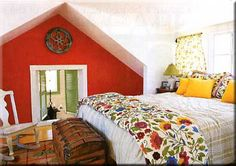 When decorating a small attic bedroom you might use furniture sparingly and try smaller items.