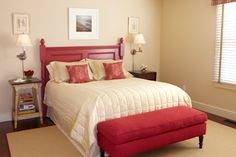 Love the the bright red headboard and bench as a footboard.