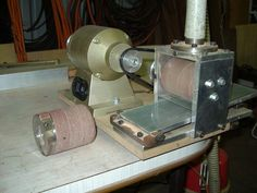 Small Thickness Sander by greenie -- Homemade small thickness sander constructed from aluminum, threaded rod, pulleys, sanding drums, an electric motor, and plexiglass.  http://www.homemadetools.net/homemade-small-thickness-sander