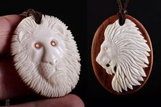 2 Lion head pendants. Beefbone and plum tree wood. Eyes inlayed with plum and copper. Size 4,5 x 3,5cm. #bonecarving #pendant