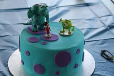 Eve's Offcuts: Monsters Inc. Party for Owen. I have almost these exact figurines for Ezzy's cake. And this is just how I imagined his cake to look. I wonder if I can master fondant before then? :)