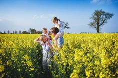 Family walking in the flowering rapeseed field