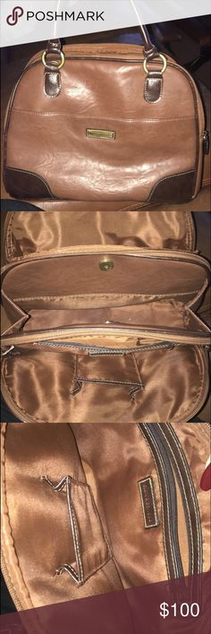 HAS ANYONE EVER SEEN THIS BAG? I have searched online and cannot find another bag like this. The brand is Croft and Barrow and the leather feels real, but I can tell the bag is old by the style and the size of the cell phone pocket (my iPhone 7 has plenty of room in it). The bag is literally like an accordion, has three deep spots for things I could probably fit enough for a two day trip in here. HAS ANYONE EVER SEEN THIS BEFORE? (Willing to sell, but also not sure how to price this lol)…