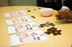 Kindergarten students practice sorting coins during guided math