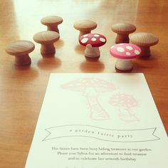 a fairie garden party. mushroom stamped invitation and wooden mushroom knobs