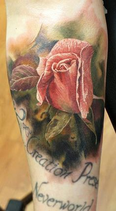 Stunning realistic rose tattoo. Ive always loved black and grey but these colored roses are making me think twice