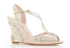 Wedges are a winner when it comes to your wedding shoes as they're super comfy so you know you'll last all day and night in them. These pretty art deco style wedges from Emmy London would look amazing with a 1920s wedding dress.