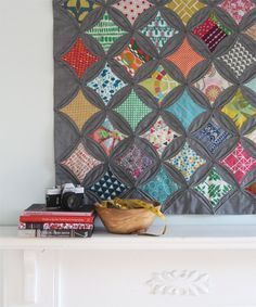 Cathedral Windows Quilt: i have seen this with white and am loving this in the grey.