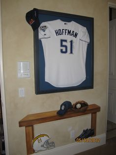 use one of Wes's old jersery's with timmons on the back and attach to some wood planks or frame it for wall art!