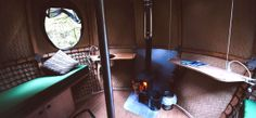 Woodburner, interior, Lost Meadow Tree tent, Broom Park Farm, Cornwall