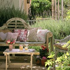 rustic bench in a rustic garden, just my kind of place to get lost with a few magazines and lemonade.