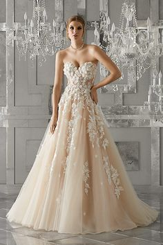 Wedding gown by Morilee by Madeline Gardner.