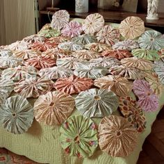 Bedspread covered with fabric flower yoyos