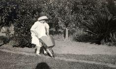 vintage photo 1916 MArgaret Plays Garden Wheelbarrow Ominous Shadow unusual