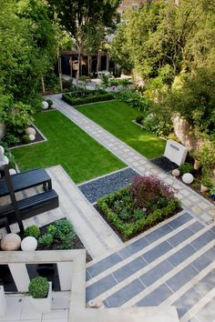 The garden has been loosely based on a Japanese style garden with simple lines and repetition. A paved area directly at the top of the terrace allows option for a table and chairs to be placed on it for formal dining. Two pathways lead off from this area.