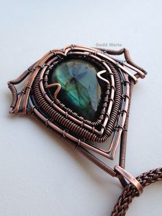 Assassin's Creed logo pendant. Labradorite in copper. Made by Gedő Mária.