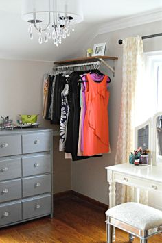 furniture for small spaces Inexpensive dress room. Check out this gorgeous converted bedroom makeover--- vanity in front of window, vintage lighting, garment racks, small dresser w/ vanity tray, build in laundry sorter Small Dresser, Mirrored Dresser, Diy Home, Home Decor, Diy Casa, Garment Racks, Home And Deco, My New Room, Apartment Living