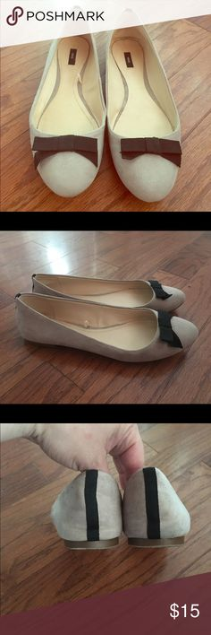 MNG bone color flats with black bow MNG bone color flats with black bow detail. Worn once. Fabric material, feels like suede but manmade felt material. Size 9. Mango Shoes Flats & Loafers