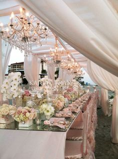 chandeliers lavish blush soft pinks white tent wedding
