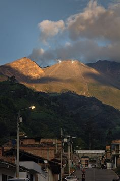 While the night has come to Consacá village, the last sun rays fill of color the top of Galeras volcano, showing us the crater and permanent fumarole. Patio, Mount Rainier, Seattle Skyline, Land Scape, Explore, Instagram, Places, Nature, Travel