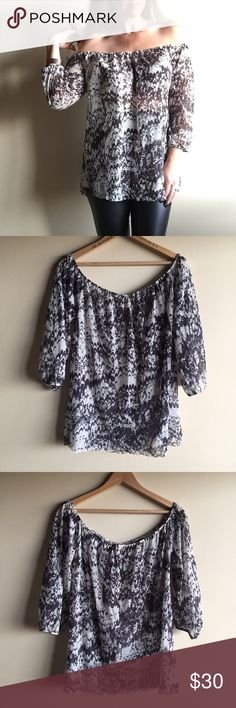 """Anthropologie off the shoulder top Super cute and trendy top by Sweet Pea. Can be worn off the shoulder or not. Semi sheer 100% nylon. Charcoal black and cream print. Measures 20"""" from underarm to underarm and 24"""" long. Loose fit, will work for size medium too! Great condition!! Anthropologie Tops"""