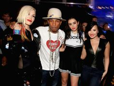 Gwen Stefani, Pharrell Williams, Charlie XCX, and Demi Lovato got together at KIIS FM's Jingle Ball concert in LA on Friday.
