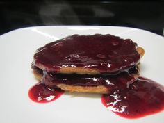 """Sorghum pancakes smothered in freshly made blueberry sauce. Recipes from """"The Healthy Gluten-Free Life"""" by Tammy Credicott. This book has 200 Gluten, dairy, soy, egg free recipes. Highly recommend."""