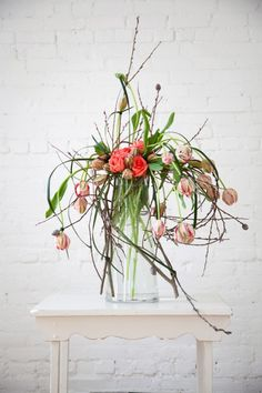 Beautiful floral arrangement with roses, tulips and pussy willow
