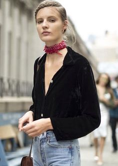 Street style- black velvet button-up shirt, jeans, delicate red & white…