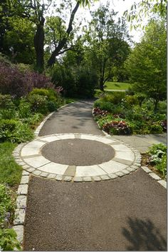 use round stone mosaic for intersection...... Chanticleer garden pathway intersection