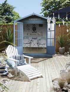 via uktv.co.uk This design style is reminiscent of a beach style house. The hut is there for rainy days, and the shells, blue theme, white rocks, and wood textures and desert plants all come togeth…