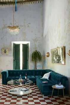 living room turquoise sofa and tiles