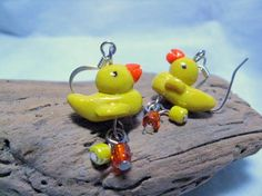 These two little yellow Rubber Duckies are just hanging around waiting for you to buy them and take them home. Handmade from bright…