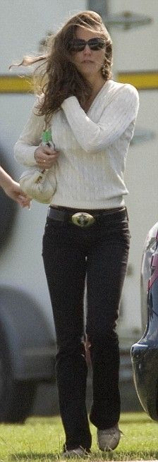 Kate wearing black Hudson jeans, ivory cable-knit sweater, Puma trainers, Chanel shades, and carrying her Prada Boston bag, at the polo in 2008.