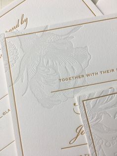 Spring floral letterpress wedding invitation with a hint of gold. Lovely rose illustration in a subtle tint of gray ink.