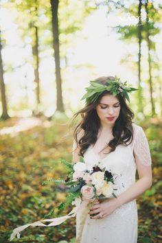 A Graceful Breeze Through The Trees #bride #outdoors #nature #weddings #white #green #lace #bouquet #flowers #dress #flowercrown #glowing #ideas #weddinginspiration #mangostudios Photography by Mango Studios