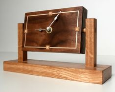This 1930's inspired desk clock is made of walnut and has sycamore inlay. It was made by David Towers cabinet-maker and is designed so that the face can be tilted to any angle. www.davidtowers.biz
