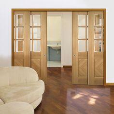 Deanta Quad Telescopic Pocket Kensington Oak Doors - Clear Bevelled Safety Glass - Prefinished.    #pocketdoors  #slidingdoors  #interiordoors  #telescopicdoors