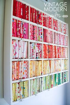 VMQ Studio, via Flickr - idea to turn my white Ikea shelves on side and stack them, with bolts of fabric standing upright in color-coordinated ranks